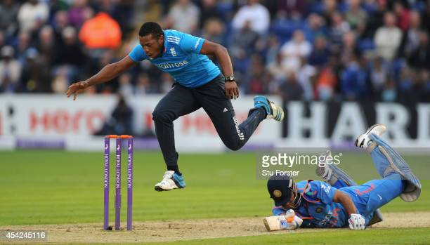 England bowler Chris Jordan attempts to run out India batsman MS Dhoni during the 2nd Royal London One Day International match between England and...