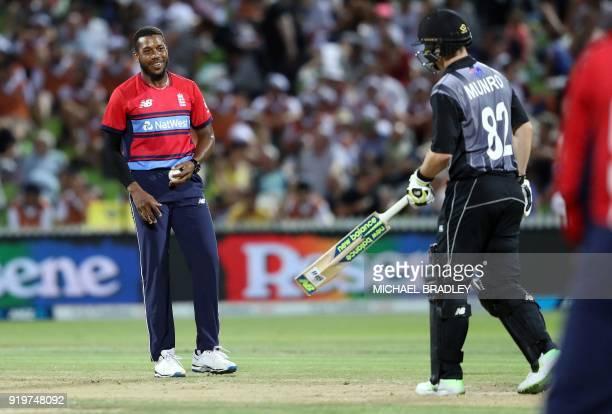 England bowler Chris Jordan looks towards New Zealand batsman Colin Munro during the Twenty20 Tri Series international cricket match between New...