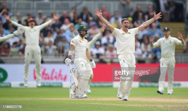 England bowler Chris Woakes appeals with success for the wicket of Matthew Wade which is given out after review during day one of the First...