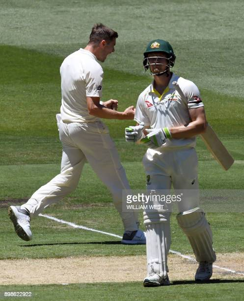 England bowler Chris Woakes celebrates after dismissing Australia's batsman Cameron Bancroft on the first day of the fourth Ashes cricket Test match...