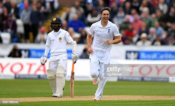 England bowler Chris Woakes celebrates after dismissing Dimuth Karunaratne during day three of the 2nd Investec Test match between England and Sri...
