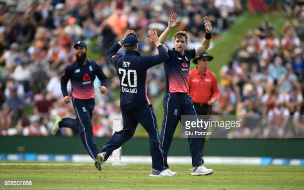 England bowler Chris Woakes celebrates after dismissing Martin Guptill during the 4th ODI between New Zealand and England at University of Otago Oval...