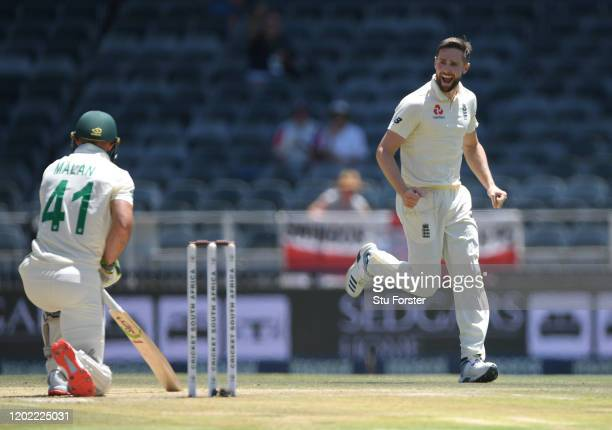 England bowler Chris Woakes celebrates after taking the wicket of Pieter Malan during Day Four of the Fourth Test between South Africa and England at...