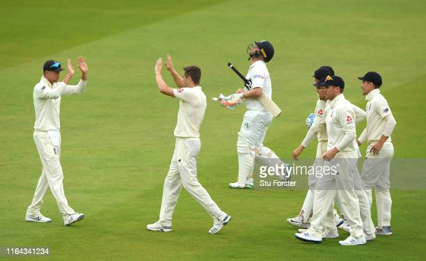 England bowler Chris Woakes celebrates with Joe Root after Woakes had bowled Ireland batsman Paul Stirling during day three of the Specsavers Test...