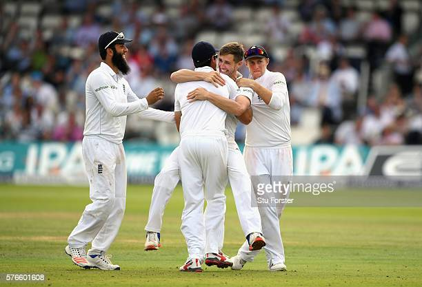 England bowler Chris Woakes celebrates with team mates after taking the wicket of Pakistan batsman Sarfraz Ahmed for his 10th wicket in the match...
