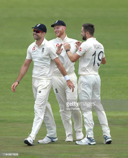 England bowler Chris Woakes is congratulated by James Anderson and Ben Stokes after taking the wicket of Snyman during day two of the 2 Day Practice...