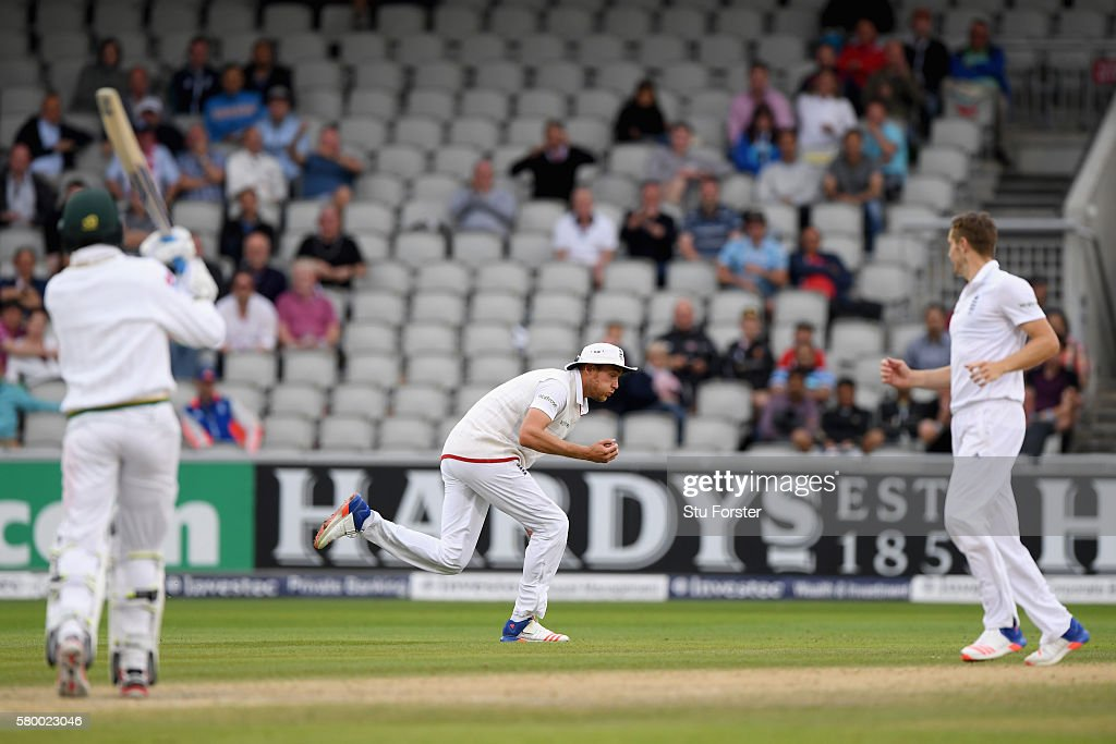 England bowler Chris Woakes looks on as fielder Stuart Broad (C) catches Pakistan batsman Mohammad Amir to win the game during day four of the 2nd Investec Test match between England and Pakistan at Old Trafford on July 25, 2016 in Manchester, England.