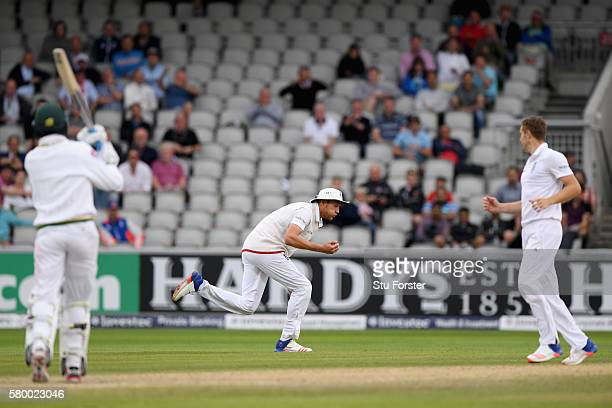 England bowler Chris Woakes looks on as fielder Stuart Broad catches Pakistan batsman Mohammad Amir to win the game during day four of the 2nd...