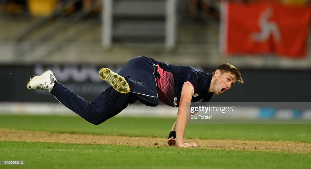 England bowler Chris Woakes reacts after deflecting a Kane Williamson drive onto the stumps to run out Mitchell Santner during the 3rd ODI between New Zealand and England at Westpac stadium on March 3, 2018 in Wellington, New Zealand.