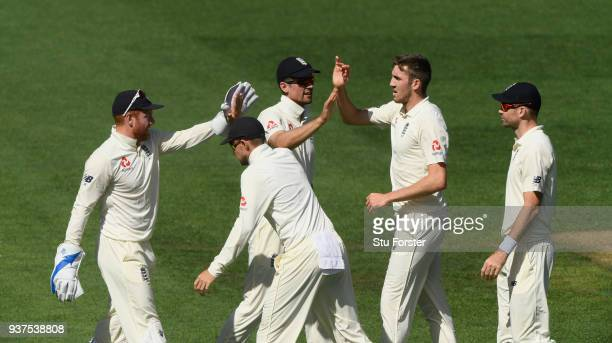 England bowler Craig Overton celebrates with team mates after dismissing Colin de Grandhomme during day four of the First Test Match between the New...