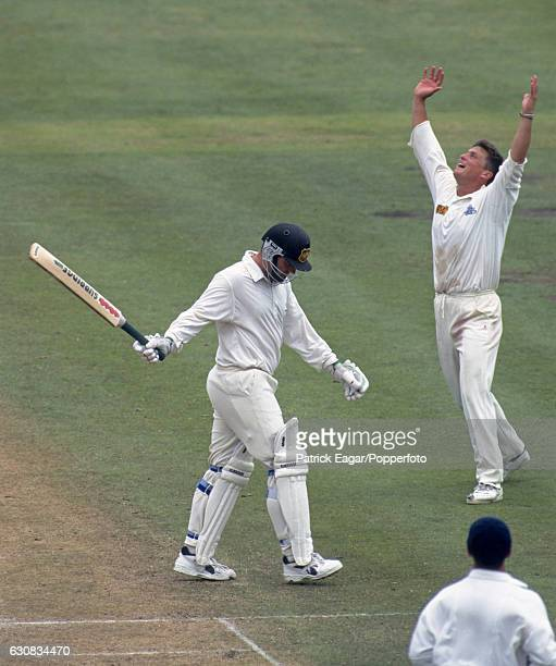 England bowler Darren Gough celebrates after catching Mark Taylor of Australia off his own bowling during the 3rd Test match between Australia and...