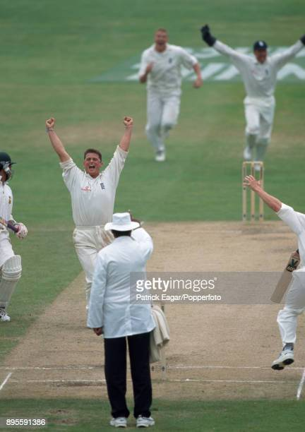 England bowler Darren Gough celebrates the final South African wicket of Makhaya Ntini on the final day of the 5th Test match between England and...