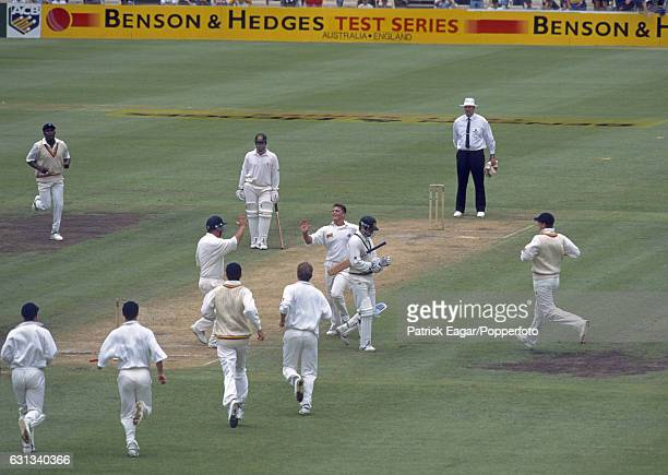 England bowler Darren Gough celebrates with teammate Mike Gatting after dismissing Steve Waugh of Australia for 1 run during the 3rd Test match...