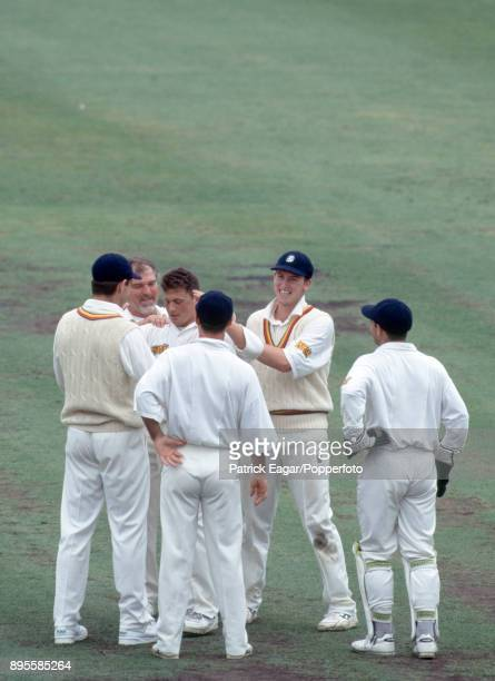 England bowler Darren Gough is congratulated by Graeme Hick Mike Gatting Graham Thorpe John Crawley and Steve Rhodes on one of his six wickets in...