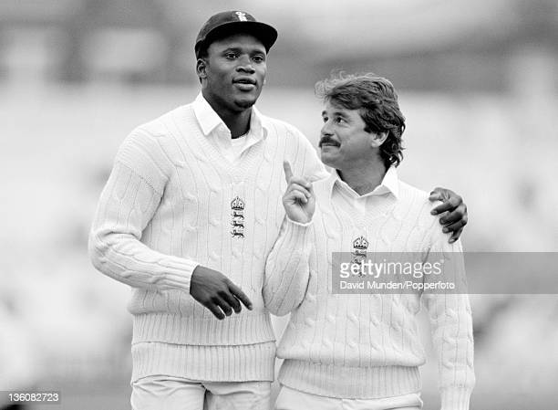 England bowler Devon Malcolm gets a word of advice from Allan Lamb during the 1st Test match between England and New Zealand at Trent Bridge in...