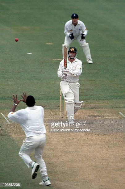 England bowler Devon Malcolm is about to drop a caught and bowled chance from Australian captain Mark Taylor who went on to score 113 during the 3rd...