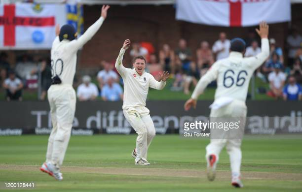 England bowler Dom Bess celebrates after catching Pieter Malan off his own bowling after a review during Day Two of the Third Test between South...