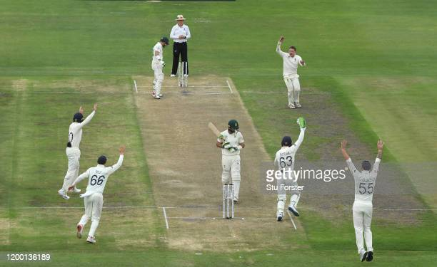 England bowler Dom Bess celebrates after catching Pieter Malan off his own bowling which is given after a review during Day Two of the Third Test...