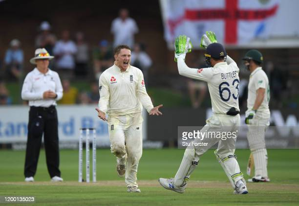 England bowler Dom Bess celebrates after dismissing batsman Zubayr Hamza during Day Two of the Third Test between South Africa and England at St...