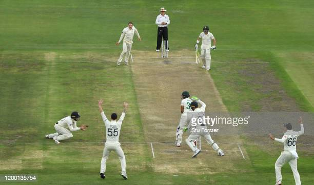 England bowler Dom Bess celebrates as batsman Zubayr Hamza is caught by Ollie Pope at short leg during Day Two of the Third Test between South Africa...
