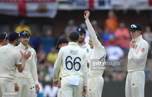 England bowler Dom Bess celebrates by holding aloft the ball after taking the wicket of Rassie van der Dussen for his 5th wicket of the innings...