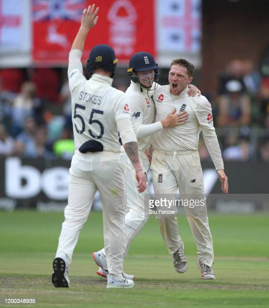 England bowler Dom Bess celebrates with Stokes and Ollie Pope after taking the wicket of Rassie van der Dussen for his 5th wicket of the innings...