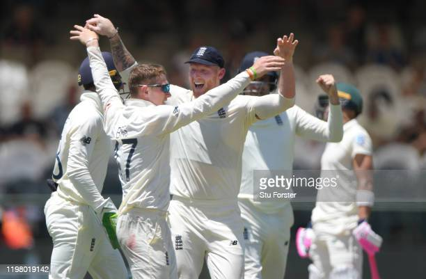 England bowler Dom Bess is congratulated by team mates after taking the wicket of Faf du Plessis during Day Five of the Second Test between South...