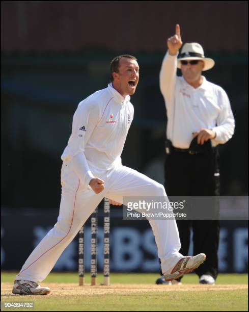 England bowler Graeme Swann celebrates after taking his second wicket in his first over in Test matches during the 1st Test match between India and...