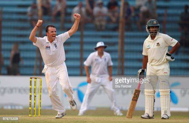England bowler Graeme Swann celebrates after taking the wicket of Bangladesh batsman Shakib Al Hasan during day two of the 1st Test between...