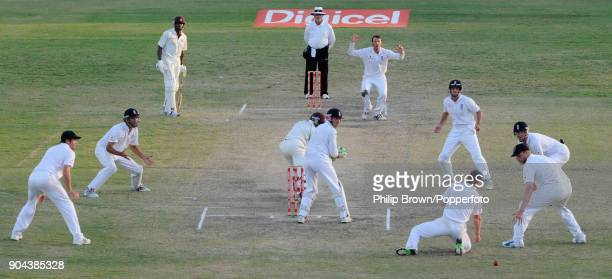 England bowler Graeme Swann reacts as an edge from West Indies batsman Fidel Edwards goes past England fielder Paul Collingwood during the final...