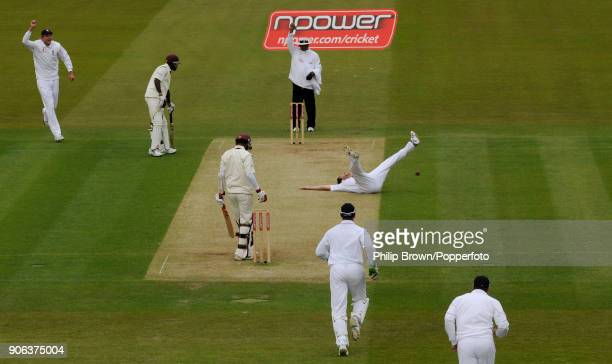England bowler Graham Onions celebrates the wicket of West Indies batsman Denesh Ramdin after slipping to the ground during his appeal in the 1st...
