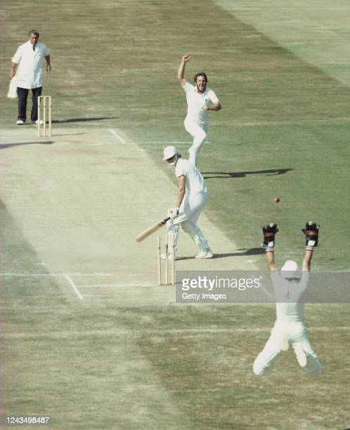 England bowler Ian Botham celebrates after bowling Terry Alderman for 0 as wicketkeeper Bob Taylor leaps to celebrate as England defeat Australia by...