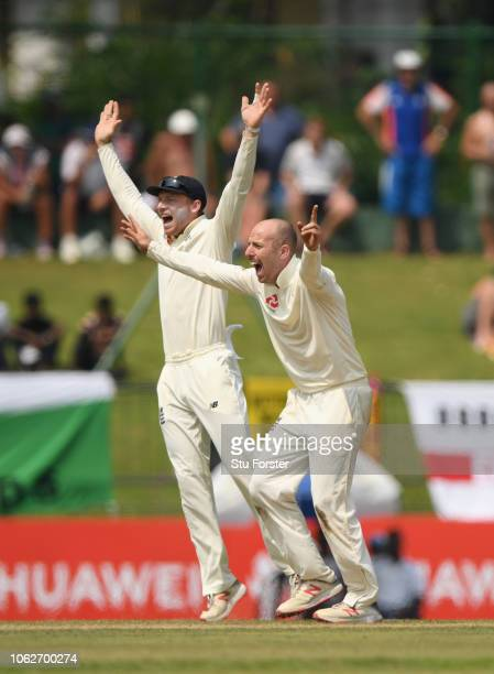 England bowler Jack Leach and Jos Buttler appeal succesfully after review for the wicket of Sri Lanka batsman Kusal Mendis during Day Four of the...