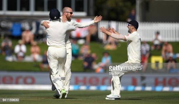 England bowler Jack Leach celebrates his first test wicket of Ross Taylor with Jonny Bairstow and Mark Wood during day five of the Second Test Match...