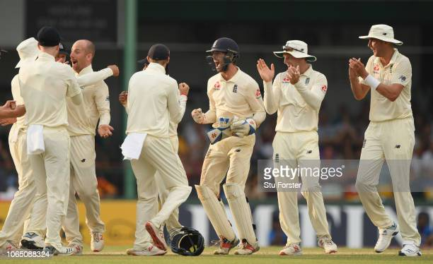 England bowler Jack Leach celebrates with captain Joe Root and team mates after taking the wicket of de Silva after a review during Day Three of the...