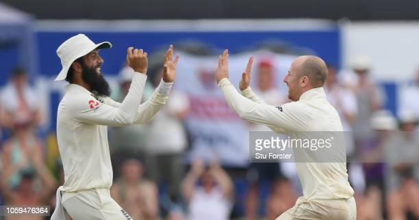 England bowler Jack Leach celebrates with Moeen Ali after dismissing Sri Lanka batsman Kusal Mendis during Day Four of the First Test match between...