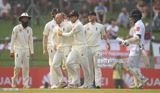 England bowler Jack Leach is congratulated by Joe Root and team mates after bowling Sri Lanka batsman Kaushal Silva during Day One of the Second Test...