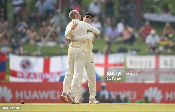 England bowler Jack Leach is congratulated by Jos Buttler after Leach had dismissed Sri Lanka batsman Dilruwan Perera during Day Two of the Second...