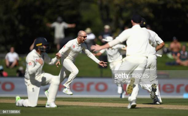 England bowler Jack Leach takes off in celebration after taking his first test wicket of Ross Taylor during day five of the Second Test Match between...