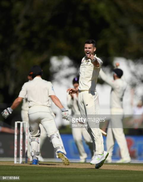 England bowler James Anderson celebrates after dismissing Henry Nicholls during day five of the Second Test Match between the New Zealand Black Caps...