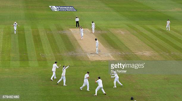 England bowler James Anderson celebrates after dismissing Pakistan batsman Shan Masood caught by Joe Root at slip during day three of the 2nd...