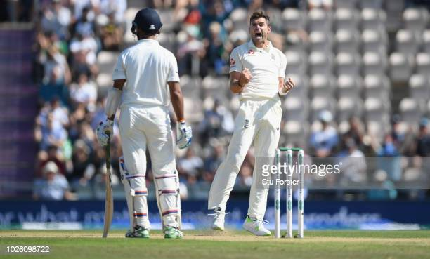 England bowler James Anderson celebrates after having India batsman Cheteshwar Pujara LBW during the 4th Specsavers Test Match between England and...