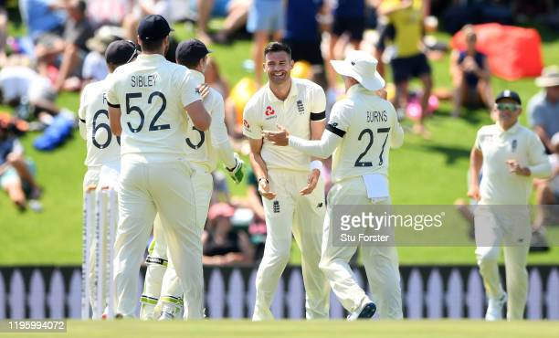 England bowler James Anderson celebrates after taking the wicket of Dean Elgar with the first ball of the match during Day One of the First Test...