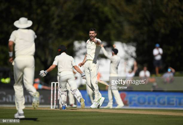 England bowler James Anderson celebrates towards Stuart Broad after dismissing Henry Nicholls during day five of the Second Test Match between the...