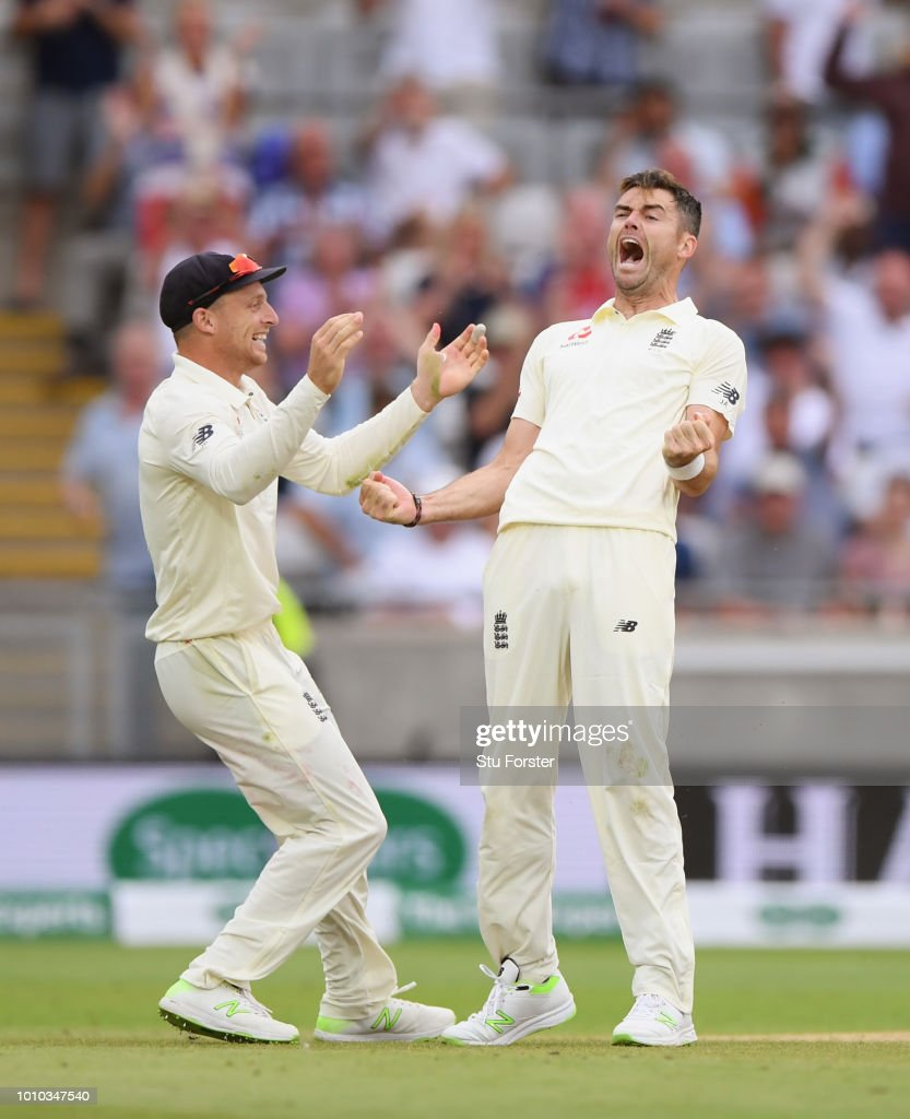 England bowler James Anderson celebrates with Jos Buttler after dismissing Ravi Ashwin during day 3 of the First Specsavers Test Match at Edgbaston on August 3, 2018 in Birmingham, England.