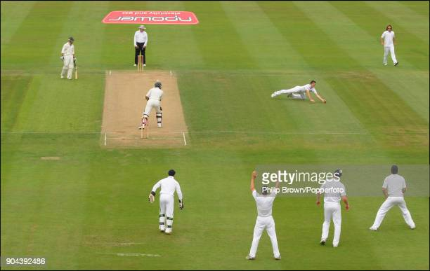 England bowler James Anderson dives to take the catch to dismiss South African batsman Hashim Amla off his own bowling during the 3rd Test match...
