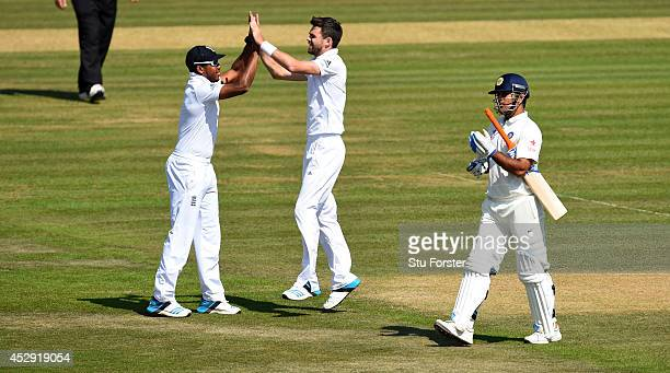 England bowler James Anderson is congratulated by Chris Jordan after taking the wicket of MS Dhoni during day four of the 3rd Investec Test match...