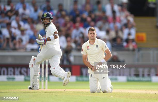 England bowler James Anderson looks on as India batsman Virat Kohli picks up some runs during day 3 of the First Specsavers Test Match at Edgbaston...