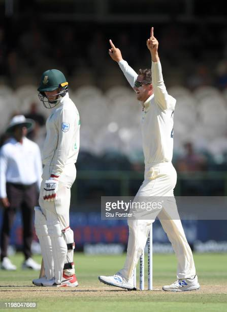 England bowler Joe Denly celebrates after taking the wicket of Quinto de Kock during Day Five of the Second Test between South Africa and England at...