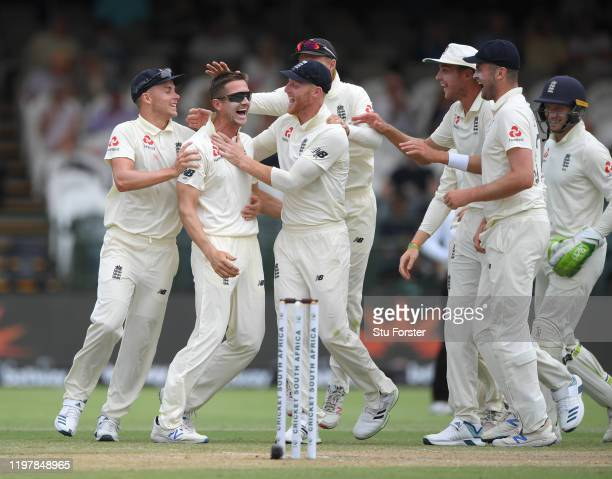 England bowler Joe Denly is congratulated by team mates after taking the wicket of South Africa batsman Dean Elgar after review during Day Four of...